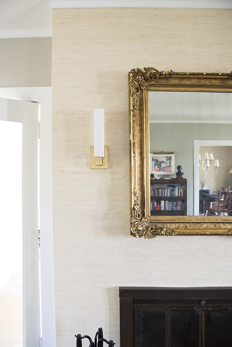 Mirror and Sconces above Fireplace