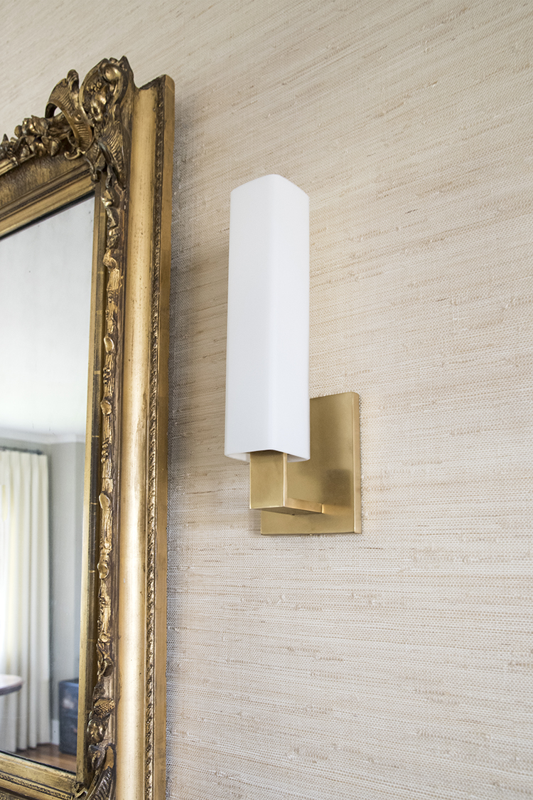 Ornate Mirror with Modern Sconce