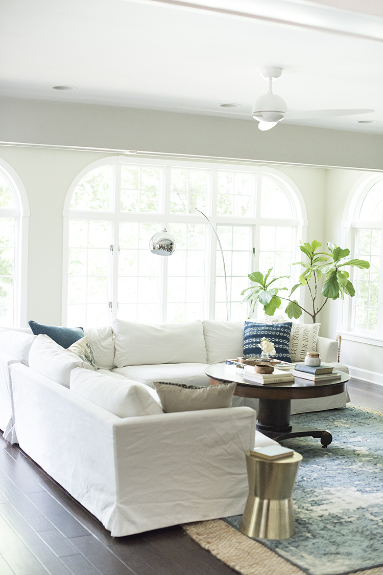 white sofa in living room a bright boho living room tour room for tuesday 23371