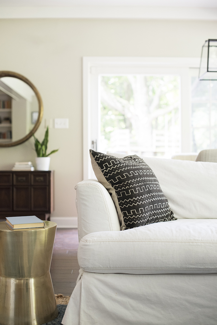 white-sofa-with-mudcloth-pillow - room for tuesday White Sofa with Pillows
