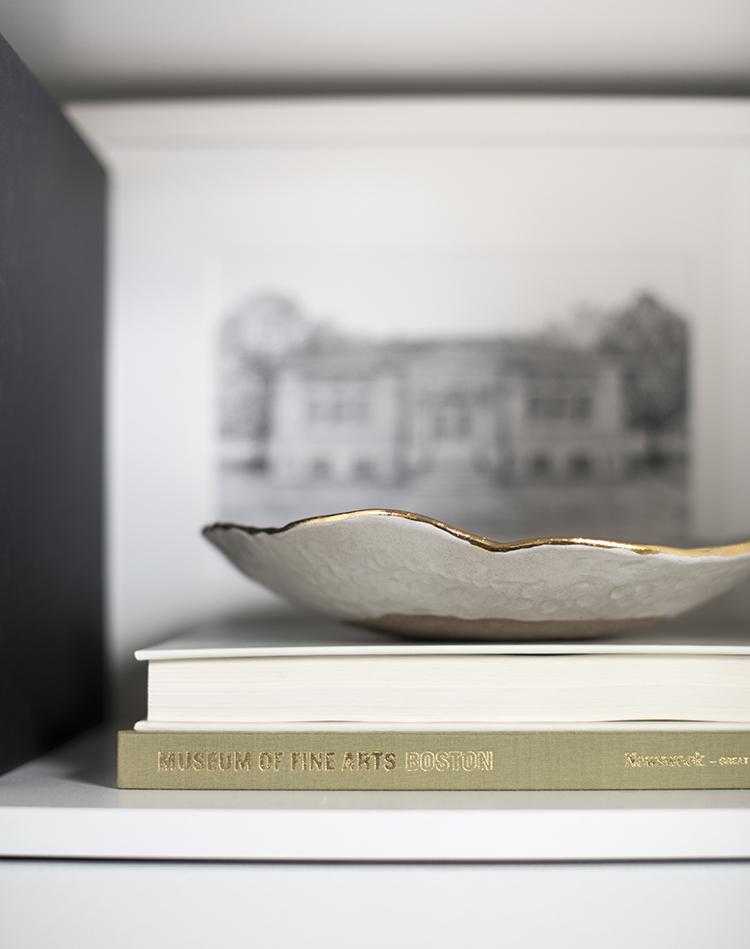 Gold Rimmed Bowl on Shelf