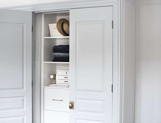 Custom Closet System Behind French Doors