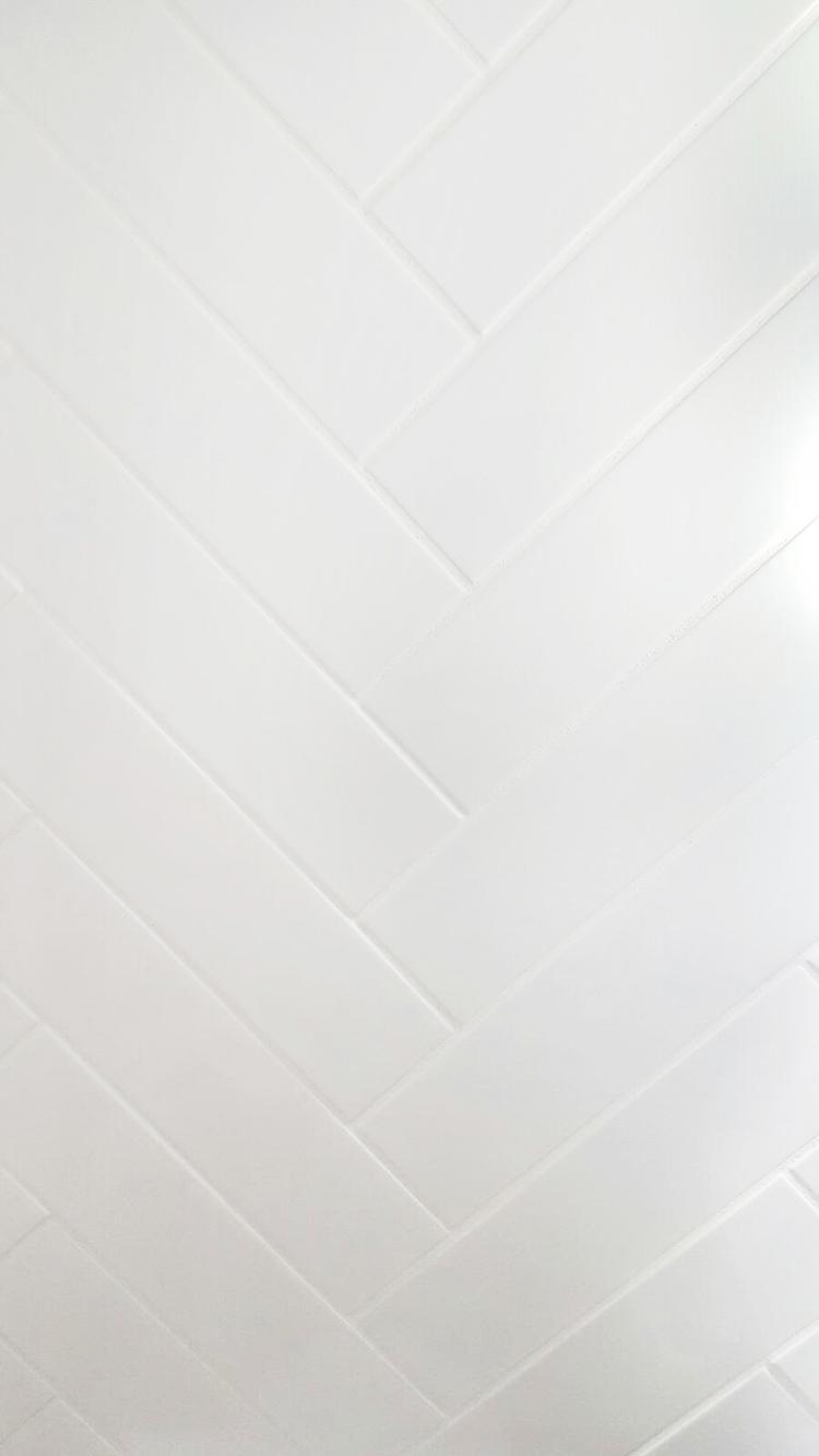White Herringbone Tile