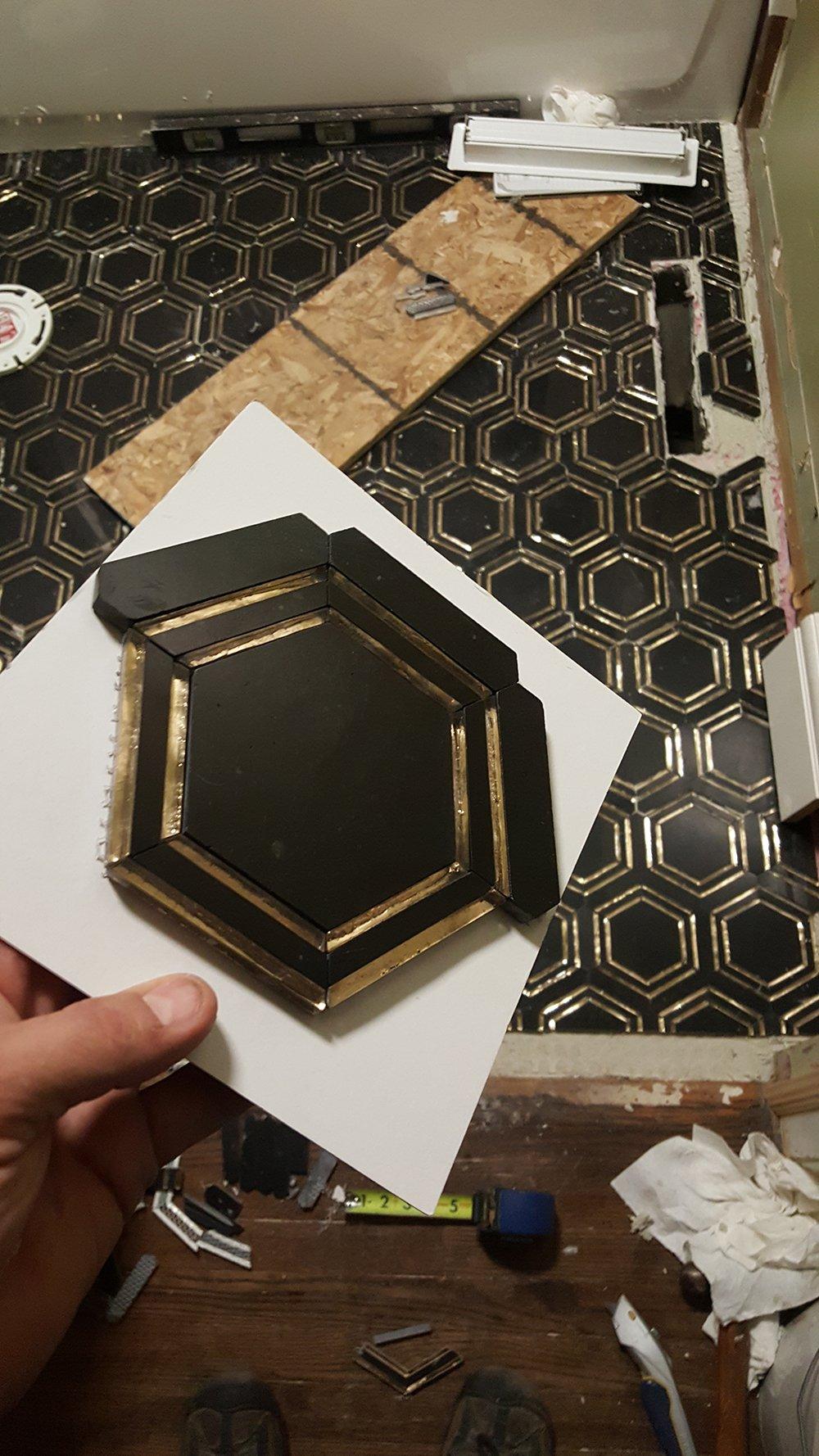 black hex floor tile in progress