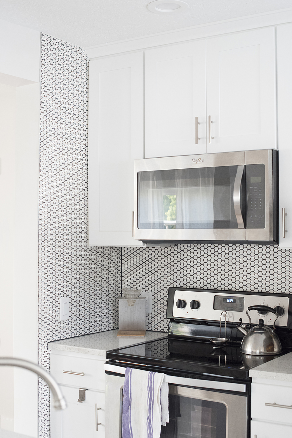 - White Hex Tile With Black Grout Backsplash - Room For Tuesday